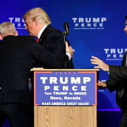 Republican presidential nominee Donald Trump is hustled off the stage by security agents after a perceived threat in the crowd on Saturday at a campaign rally in Reno, Nevada.