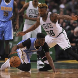 Denver Nuggets guard Emmanuel Mudiay (0) tries to gain control of the ball while Boston Celtics guard Marcus Smart (36) defends during the second half at TD Garden in  Boston on Sunday night.