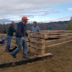 Volunteers assemble the wooden components of a mortise and tenon structure being built at the Curran Homestead Saturday. The new building will serve as the farming museum's wood working shop once it is completed.