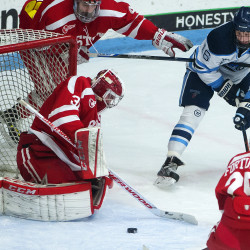 University of Maine's Dane Gibson (right) tires for the redirect shot but is stopped by Boston University's Sean Maguire during their hockey game at Alfond Arena in Orono in this January 2016 file photo.