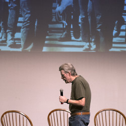 "Stephen King speaks during a book launch event Monday evening at the University of Maine in Orono. The book, ""Hearts in Suspension,"" is a collection of essays written by King and former college classmates and friends."