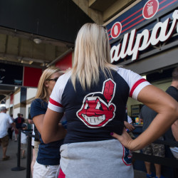 A fan waits in line for concessions at Progressive Field on July 26 in Cleveland.
