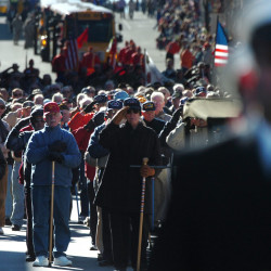 As the National Anthem was played, Maine's World War II veterans and other members of the military and public safety community joined thousands of spectators as they saluted the U.S. Flag during the Brewer-Bangor Veterans Day Parade in 2010.