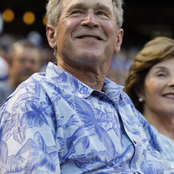 Former president George W. Bush watches the game between the Houston Astros and the Texas Rangers at Globe Life Park in Arlington.
