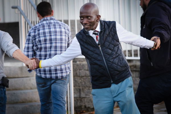 Pious Ali greets voters at the Grace Baptist Church on Summit Street in Portland on Tuesday afternoon. Ali became the first African-born Muslim elected to Portland's City Council Tuesday night.