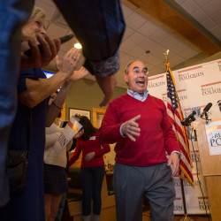 U.S. Rep. Bruce Poliquin celebrates after declaring victory over Emily Cain in the 2nd Congressional District after midnight Wednesday at Dysart's in Bangor.