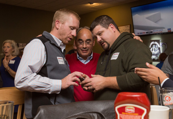 Scott Walton of Holden (left) and Jeremy Edwards of Winterport (right) talk with Rep. Bruce Poliquin during his election results party at Dysart's in Bangor on Tuesday evening.