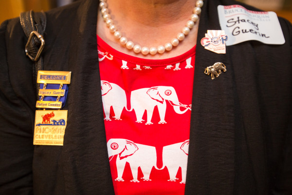 Rep. Stacey Guerin of Glenburn sports pins and a dress purchased at the Republican National Convention at Bruce Poliquin's election results party at Dysart's in Bangor on Tuesday evening.