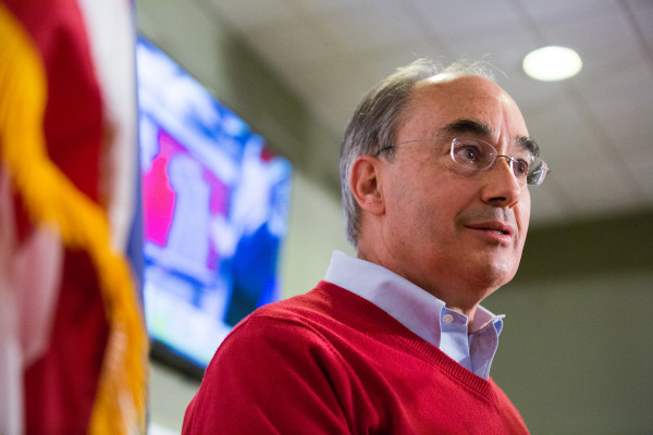 U.S. Rep. Bruce Poliquin declares victory over Emily Cain in the 2nd Congressional District after midnight Wednesday at Dysart's in Bangor.