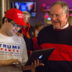 Donald Trump supporters bond over the candidate taking another swing state at an election results party hosted by U.S. Rep. Bruce Poliquin after midnight Wednesday at Dysart's in Bangor.