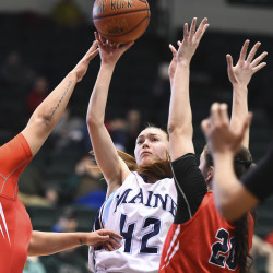 Maine's Sigi Koizar shoots over Stony Brook's Kori Bayne-Walker during an America East Tourney semifinal March 6 at the Events Center in Vestal, New York.
