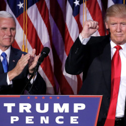 U.S. President-elect Donald Trump gestures as Vice President-elect Mike Pence applauds at their election night rally in Manhattan, New York, U.S., November 9, 2016.