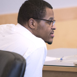 Keith Coleman, 29, of Garland sits on Oct. 26 in the court room at the Penobscot Judicial Center in Bangor. Coleman is accused of strangling his girlfriend and then killing her two children in December 2014.