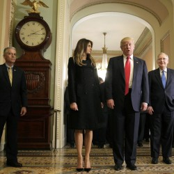 President-elect Donald Trump answers questions as his wife, Melania Trump, and Senate Majority Leader Mitch McConnell watch on Capitol Hill in Washington on Thursday.