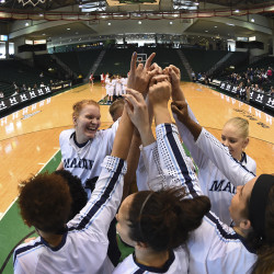 Maine basketball players huddle before the start of their America East tourney semifinal against Stony Brook in March 2016 at the Events Center in Vestal, New York.