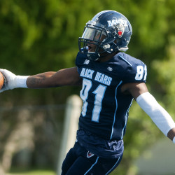 The University of Maine's Earnest Edwards celebrates after scoring touchdown against James Madison during their football game at Alfond Stadium in Orono on Sept. 24.