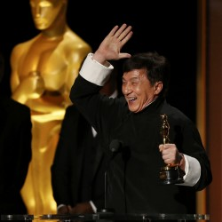 Actor Jackie Chan reacts as he accepts his honorary award at the 8th Annual Governors Awards in Los Angeles, Nov. 12, 2016.