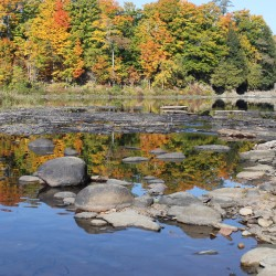 A low Piscataquis River flows by Browns Mill Park in Dover-Foxcroft. With drought conditions affecting the region, the Dover & Foxcroft Water District issued a water conservation request to its customers earlier this fall.