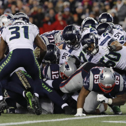 The Seattle Seahawks stop a quarterback sneak by New England Patriots quarterback Tom Brady (12) on the 1-yard line in the fourth quarter at Gillette Stadium in Foxborough, Mass., on Sunday night. The Seahawks defeated the Patriots 31-24.