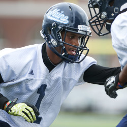 University of Maine's Najee Goode (left) goes through a drill during practice on Aug. 21, 2015 at Alfond Stadium in Orono.