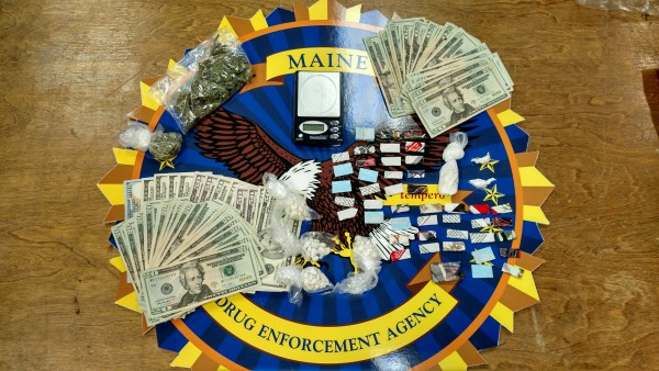 Maine Drug Enforcement Agency agents seized 53 packets of heroin, 72 bags of crack cocaine, scales, packaging materials and more than $1,500 in suspected drug proceeds during a search at an apartment on Lincoln Street in Lewiston in November 2015.