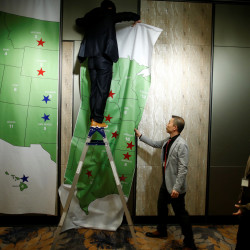 A man removes the Electoral College Map after a U.S. Election Watch event hosted by the U.S. Embassy at a hotel in Seoul, South Korea, November 9, 2016.