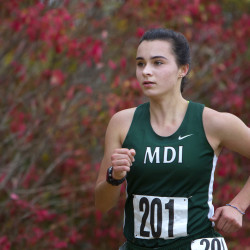 Mount Desert Island's Tia Tardy leads the pack during the Class B cross-country regional championships at Troy Howard Middle School in Belfast in this October 2016 file photo.