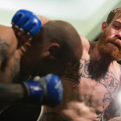 "Devin Powell (right) looks to punch Team Irish MMA Fitness Academy's Jon Lemke during their catchweight bout as part of the reality program ""Dana White: Lookin' For A Fight"" event at the Cross Insurance Center grand ballroom in Bangor in this August 2016 file photo."