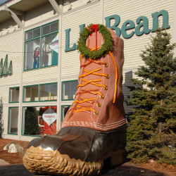 A Christmas wreath adorns the large-than-life-sized L.L. Bean boot set beside the rear entrance to the retailer's flagship store on Main Street in Freeport.