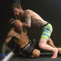 "Devin Powell (right) fights Team Irish MMA Fitness Academy's Jon Lemke during their catchweight bout as part of the reality program ""Dana White: Lookin' For A Fight"" event at the Cross Insurance Center grand ballroom in Bangor in this August 2016 file photo."