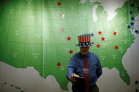A man takes a selfie in front of the Electoral College map during a U.S. election watch event hosted by the U.S. Embassy on Nov. 9 at a hotel in Seoul, South Korea.