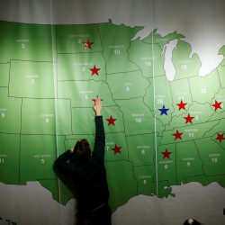 A man marks a star on the Electoral College map during a U.S. Election Watch event hosted by the U.S. Embassy on Nov. 9 at a hotel in Seoul, South Korea.