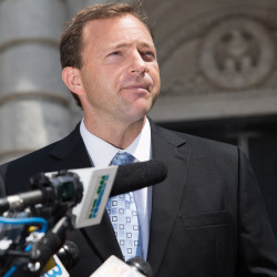 House Speaker Mark Eves addresses reporters during a press conference outside the U.S. District Court in Portland in this July 2015 file photo.
