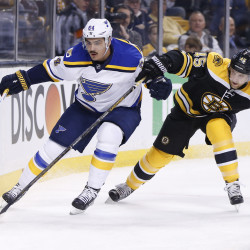 St. Louis Blues right wing Nail Yakupov (left) and Boston Bruins defenseman Joe Morrow battle for the puck during the first period at TD Garden in Boston on Tuesday night.