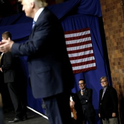 Stephen Bannon (right) looks on as Republican presidential nominee Donald Trump appears at a campaign rally in Canton, Ohio, Sept. 14, 2016.