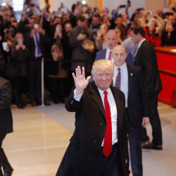 President-elect Donald Trump reacts to a crowd gathered in the lobby of the New York Times building after a meeting with the paper's editorial board in New York, Nov. 22, 2016.
