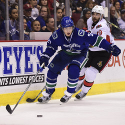 Vancouver Canucks defenseman Ben Hutton (left) chases a loose puck against the Ottawa Senators during the second period at Rogers Arena in Vancouver, British Columbia, on Oct. 25.