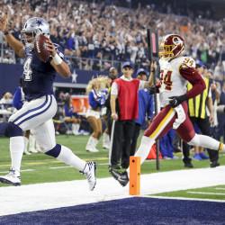 Dallas Cowboys quarterback Dak Prescott (4) runs the ball in for a touchdown against Washington Redskins outside linebacker Preston Smith (94) in the fourth quarter on Thursday, Nov. 24, 2016, at AT&T Stadium in Arlington, Texas.