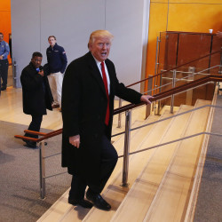 U.S. President elect Donald Trump walks up a staircase to depart the lobby of the New York Times building after a meeting in New York, U.S., November 22, 2016.