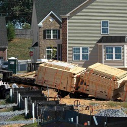 Lumber on pallets for framing new house construction are unloaded at a large subdivision in Damascus, Maryland, U.S. on September 15, 2015.