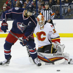 Columbus Blue Jackets left wing Nick Foligno (71) takes a shot against Calgary Flames goalie Chad Johnson (31) during the second period at Nationwide Arena.