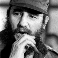 Then Cuban President Fidel Castro smokes a cigar during a meeting of the National Assembly in Havana, Dec. 2, 1976.