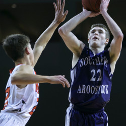 Southern Aroostook's Jackson Mathers (right) shoots over Machias' Alessandro Marotta during Southern Aroostook's Class D North semifinal win last season at the Cross Insurance Center. Both teams should be at the top of their class this season.