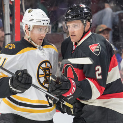 Jimmy Hayes of the Boston Bruins (left), pictured during a Nov. 24 game against  Ottawa, scored a goal for his first point in 36 games on Sunday as the Bruins beat the Tampa Bay Lightning 4-1.