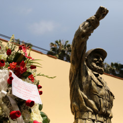Flowers are seen next to a statue of Cuban revolutionary leader Fidel Castro following the announcement of his death inside the Cuban embassy in Lima, Peru, November 26, 2016.