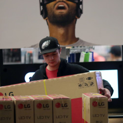 A shopper shops during Black Friday sales at a Best Buy store in Los Angeles on Nov. 25.