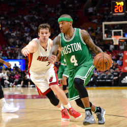 Boston Celtics guard Isaiah Thomas (4) drives to the basket as Miami Heat guard Goran Dragic (7) applies pressure during the second half at American Airlines Arena. The Celtics won 111-102.