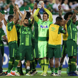 Players of Chapecoense celebrate after their match against San Lorenzo at the Arena Conda stadium in Chapeco, Brazil, Nov. 23, 2016. An aircraft with 81 people aboard, including Brazilian football team Chapecoense, crashed in central Colombia, the country's civil aviation association said on its website on Nov. 29, 2016.