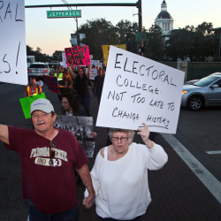 Protesters opposed to the Electoral College circle the Capitol as they demonstrate against the election of Republican Donald Trump as President of the United States in Tallahassee, Florida, Nov. 16, 2016.