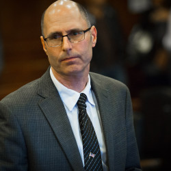 Gregory Nisbet stands up after he was found not to be guilty of manslaughter by Cumberland County Superior Court Justice Thomas Warren in Portland, Oct. 21, 2016. Nisbet is the landlord who owned the Portland building where six young adults died in a fire in 2014.